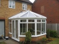 AFTER: NEW UPVC CONSTRUCTION with 35mm Clear polycarbonate roof sheets complete with silver on silver solar inserts